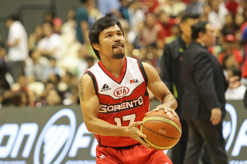 Bocaue, Bulacan Philippines - Manny Pacquiao of Kia warms up before their game against Blackwater on the 40th season opening of the Philippine Basketball Association (PBA) on October 19, 2014. Kia won 80-66 with the Filipino boxing champion and politician playing over 6 minutes with 2 turnovers and 1 foul. (Photo by Photo by Mark Cristino/NurPhoto)