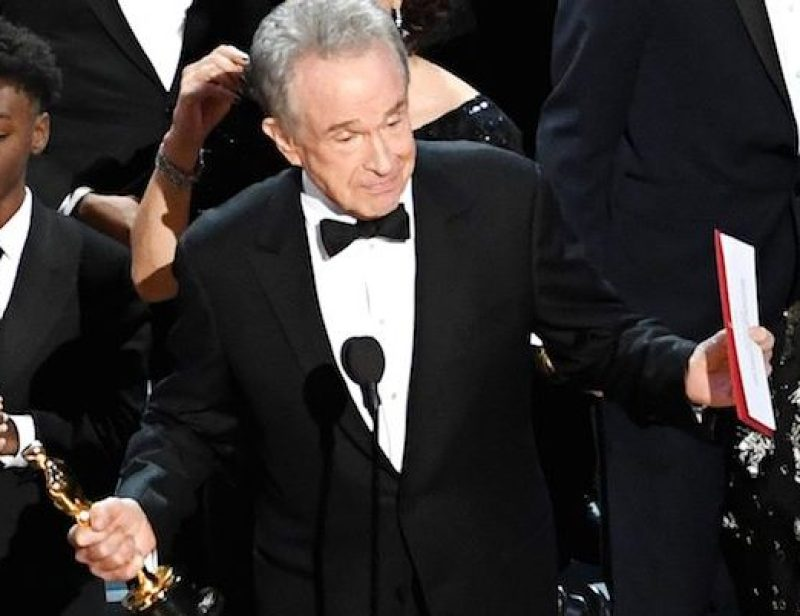 HOLLYWOOD, CA - FEBRUARY 26: Actor Warren Beatty (C) explains a presentation error which resulted in Best Picture being announced as 'La La Land' instead of 'Moonlight' onstage during the 89th Annual Academy Awards at Hollywood & Highland Center on February 26, 2017 in Hollywood, California. (Photo by Kevin Winter/Getty Images)