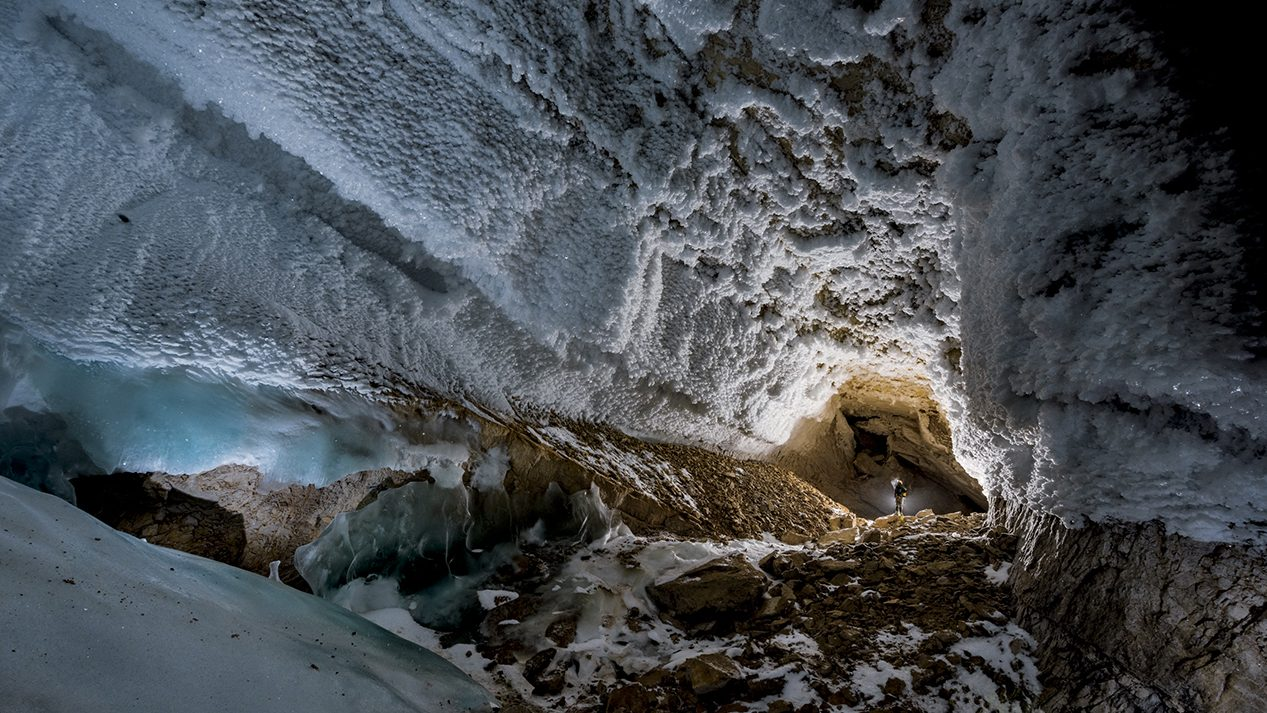 Ice crystals populate Full Moon Hall. The chamber, 820 feet long, is the largest yet discovered in Dark Star. The entire cave system is a geological time capsule: Mineral deposits reveal millennia of climate history. (Robbie Shone/National Geographic)