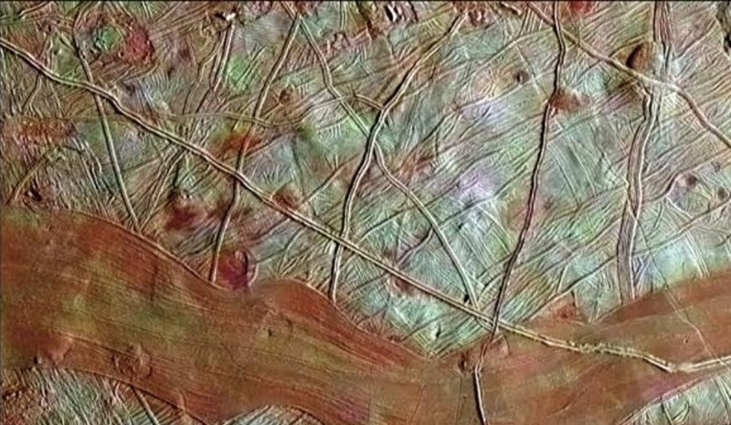 This colorized image of Jupiter's moon Europa is a product of clear-filter grayscale data from one orbit of NASA's Galileo spacecraft, combined with lower-resolution color data taken on a different orbit. The blue-white terrains indicate relatively pure water ice, whereas the reddish areas contain water ice mixed with hydrated salts, potentially magnesium sulfate or sulfuric acid (NASA/JPL-Caltech/SETI Institute)