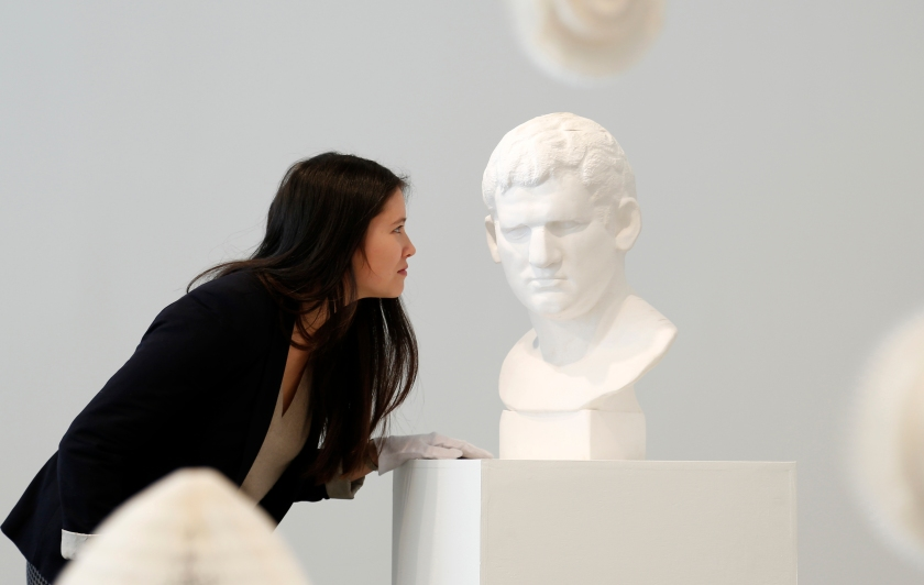 """Klein Sun Gallery hosts Chinese artist Li Hongno's """"Tools of Study"""" exhibition displaying stretchy paper sculptures formed as marble sculptures on January 23, 2014 in New York City. (Bilgin Sasmaz/Anadolu Agency/Getty Images)"""