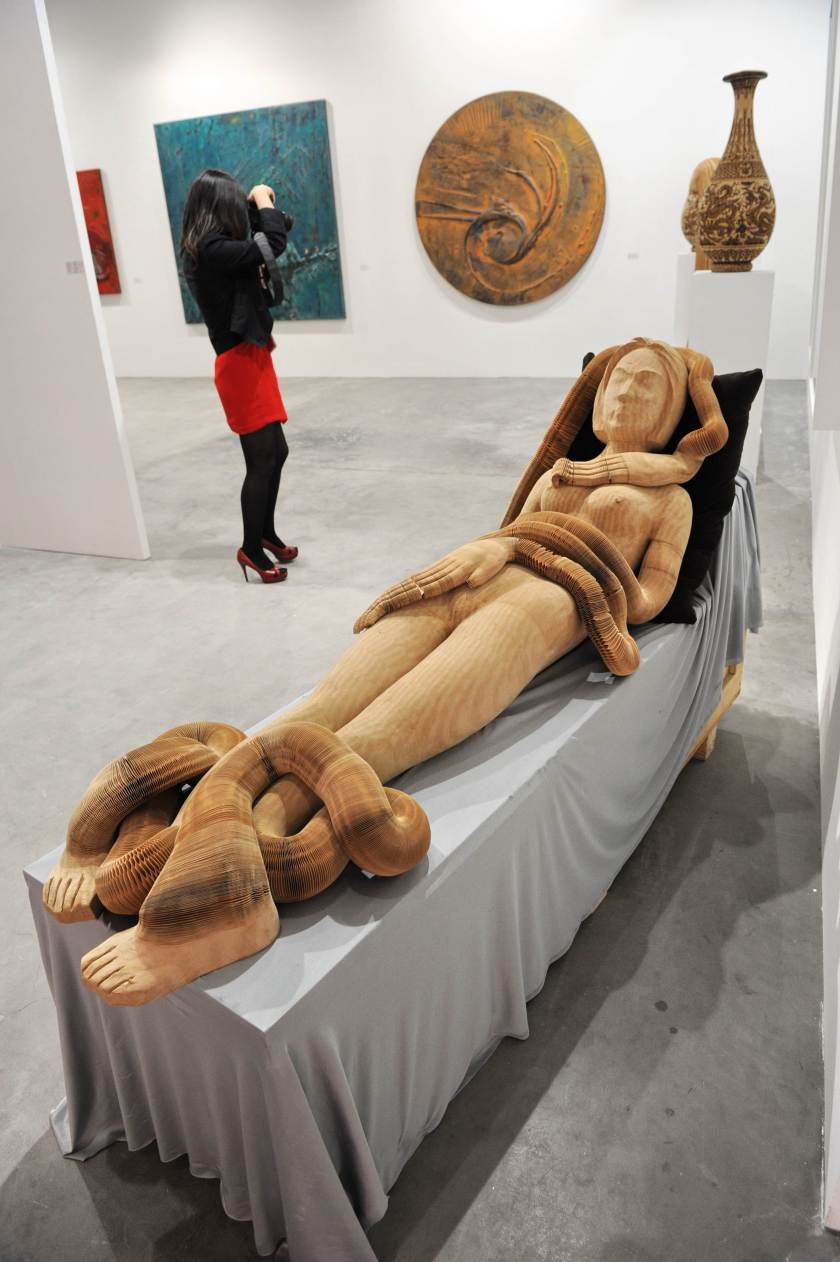 """A Paper Sculpture entitled """"Girl"""" created by Chinese sculptor Li Hongbo displayed at Art Stage Singapore. (Roslan Rahman/AFP/Getty Images)"""