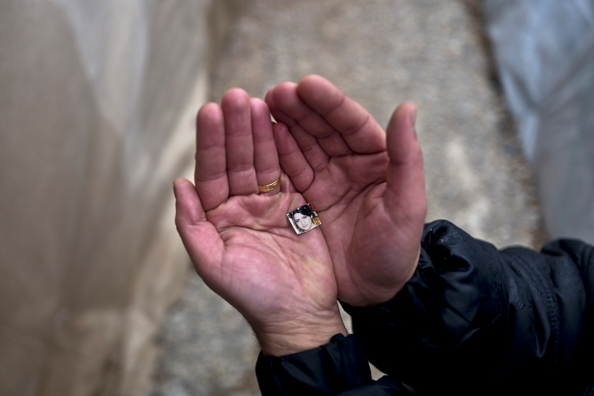 """In this Tuesday, Jan. 24, 2017 photo, Rustum Abdulrahman, 35, a Syrian refugee from the northern district of Al-Ashrafiya, Aleppo, shows a photograph of his wife Zuzan, 33, at Ritsona refugee camp, Greece. """"I keep this image always with me, I made it as small as possible so no matter what it won't be damaged and will never loose it, my wife is my best friend and the partner of my life."""" Rustum said. (AP Photo/Muhammed Muheisen)"""