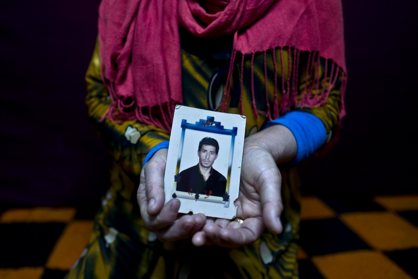 """In this Tuesday, Jan. 24, 2017 photo, Heven Daood, 39, a Syrian refugee from Tell-Tawil in al-Hasaka, shows a photograph of her husband Reiad, 45, at her shelter in Ritsona refugee camp, Greece. """"I have this photograph with me for the last 10 years, it is a very precious picture, my husband used to travel a lot for work and this image always remained close to my heart."""" Heven said. (AP Photo/Muhammed Muheisen)"""