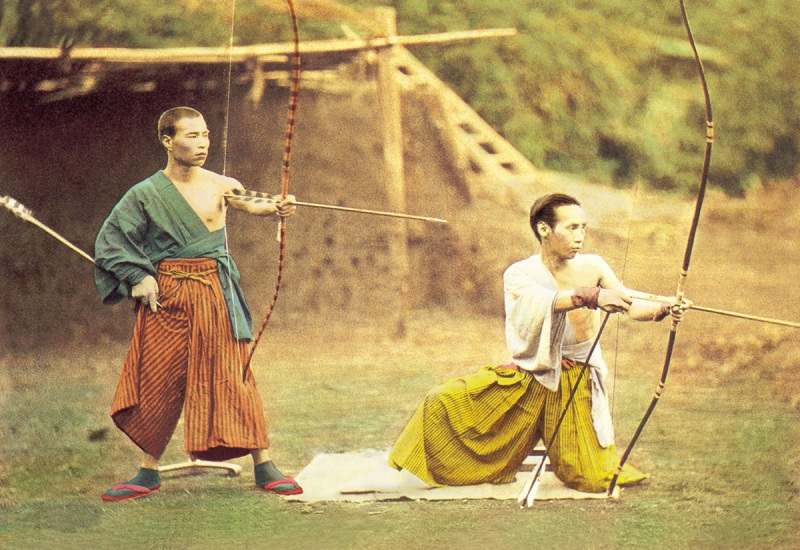 Two Japanese archers take aim at a target, circa 1897. (Buyenlarge/Getty Images)