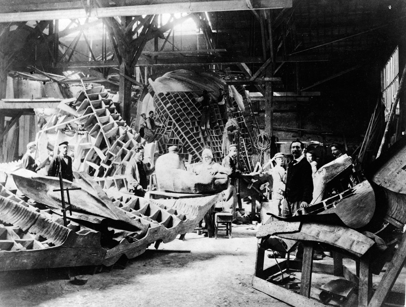 View of portions of the Statue of Liberty during its construction in the workshop of French sculptor Frederic Auguste Bartholdi, Paris, France, circa 1880. Bartholdi stands at left. (Photo by Musee Bartholdi/Authenticated News/Getty Images)