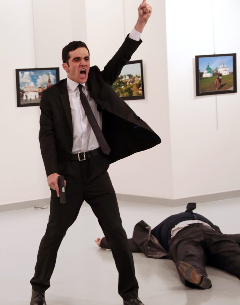 World Press Photo of the Year: Mevlut Mert Altintas shouts after shooting Andrei Karlov, right, the Russian ambassador to Turkey, at an art gallery in Ankara, Turkey, Monday, Dec. 19, 2016. (AP Photo/Burhan Ozbilici)