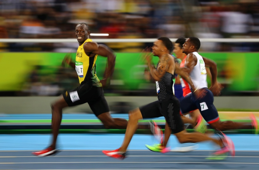 Sports - Third Prize, Singles: Usain Bolt of Jamaica smiles as he looks back at his competition, whilst winning the 100-meter semi-final sprint, at the 2016 Olympics in Rio de Janeiro, Brazil. Bolt is regarded as the fastest human ever timed. He is the first person to hold both the 100-meter and 200-meter world records since fully automatic time became mandatory. (Kai Oliver Pfaffenbach/Thomson Reuters)
