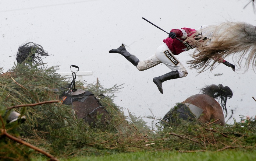 Sports - First Prize, Singles: Jockey Nina Carberry flies off her horse Sir Des Champs as they fall at The Chair fence during the Grand National steeplechase during day three of the Grand National Meeting at Aintree Racecourse on April 9th 2016 in Liverpool, England. (Tom Jenkins/The Guardian)