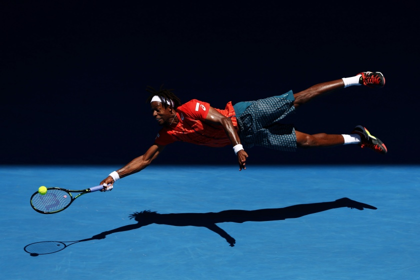 Sports - Second Prize, Singles: Gaël Monfils of France dives for a forehand in his fourth round match against Andrey Kuznetsov of Russia, during the 2016 Australian Open at Melbourne Park, Australia, on 25 January 2016. The Australian Open holds the record for the highest attendance at a Grand Slam event. (Cameron Spencer/Getty Images)