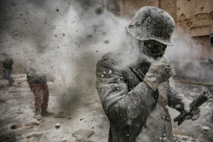 """People - Second Prize, Stories: On 28 December each year, the """"Floured War"""" takes place in Ibi in the province of Alicante, Spain. During the festival, the citizens are divided into two groups: the 'Enfarinat' (the floured) group simulates a coup d'etat and a second group tries to calm the rebellion. The teams play with flour, water, eggs and colored smoke bombs. The 200-year-old tradition is known as """"Els Enfarinats"""", marking the biblical Massacre of the Innocents by King Herod. (Antonio Gibotta/Agenzia Controluce)"""