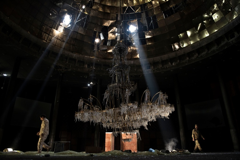 General News - Third Prize, Stories: Fighters of the Libyan forces affiliated to the Tripoli government walk around the gigantic chandelier of the conference room in Ouagadougou Congress Complex. Sirte, Libya, is one of the three self-proclaimed capitals of the so-called Islamic State, along with Raqqa in Syria and Mosul in Iraq. It was the first of the three to fall, with an offensive launched by the Libyan government in May 2016. It took seven months of fighting, 500 American airstrikes, the lives of 700 Libyan soldiers and more than 3,000 injured Libyan soldiers to finally declare the city free. (Alessio Romenzi)