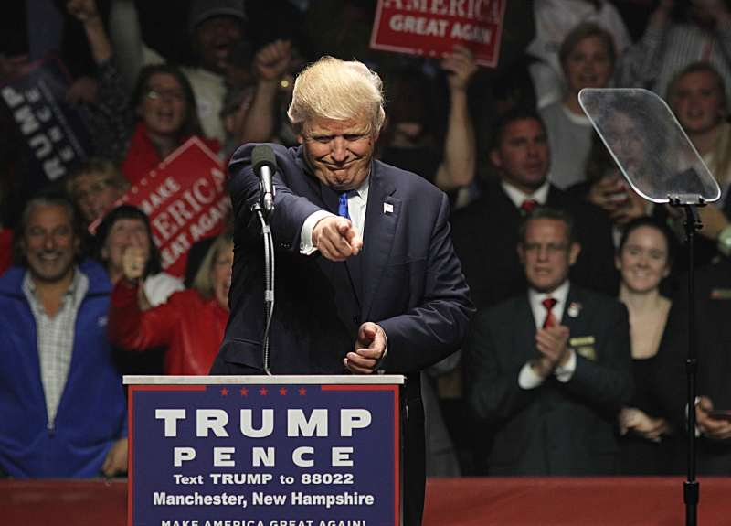 Donald Trump speaks at a rally in New Hampshire the night before the 2016 election.