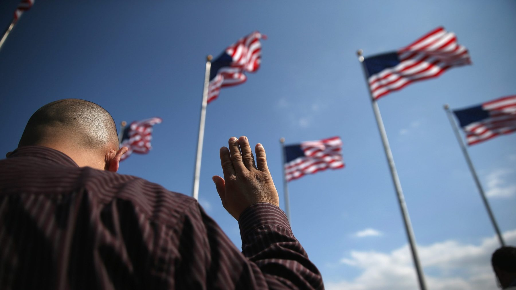 Immigrants take the oath of citizenship to the United States during a naturalization ceremony at Liberty State Park on September 19, 2014 in Jersey City, New Jersey. (John Moore/Getty Images)