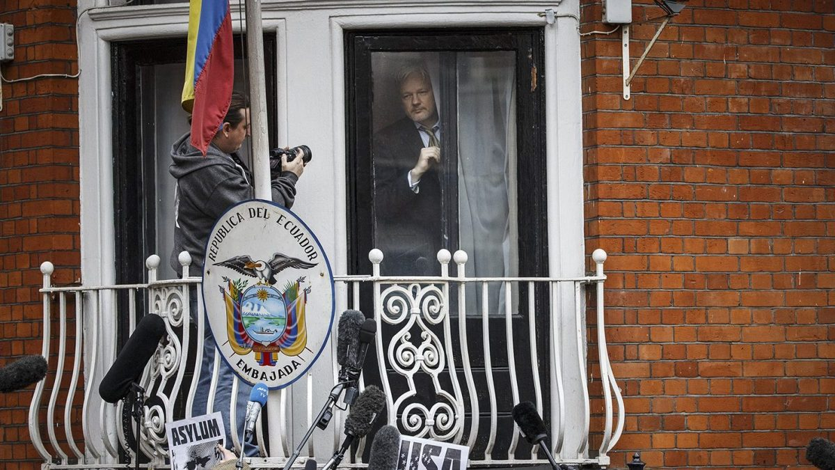Wikileaks founder Julian Assange prepares to speak from the balcony of the Ecuadorian embassy where he continues to seek asylum following an extradition request from Sweden in 2012, on February 5, 2016 in London, England. The United Nations Working Group on Arbitrary Detention has insisted that Mr Assange's detention should be brought to an end. (Tolga Akmen/Anadolu Agency/Getty Images)