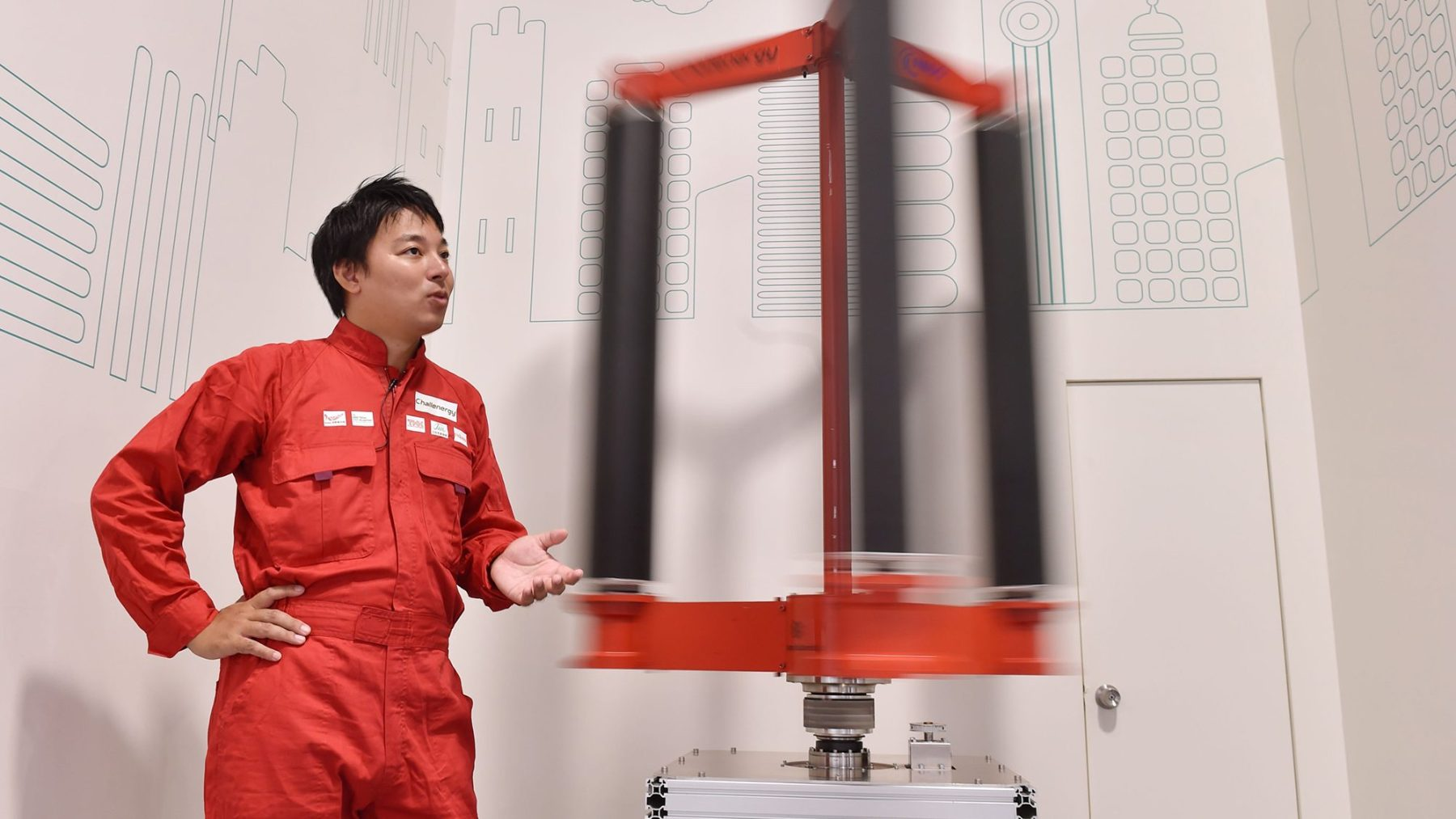 This picture taken on October 20, 2016 shows engineer Atsushi Shimizu, founder and CEO of the Japanese venture company Challenergy, standing next to his bladeless wind turbine in Tokyo. The amount of electricity produced by wind nearly doubled in 2016 from a year earlier, according to a recent survey by the Japan Wind Power Association. But wind power's share of Japan's total energy mix is still less than one percent. / AFP PHOTO / Kazuhiro NOGI / TO GO WITH Japan-energy-environment,FOCUS by Harumi Ozawa        (Photo credit should read KAZUHIRO NOGI/AFP/Getty Images)