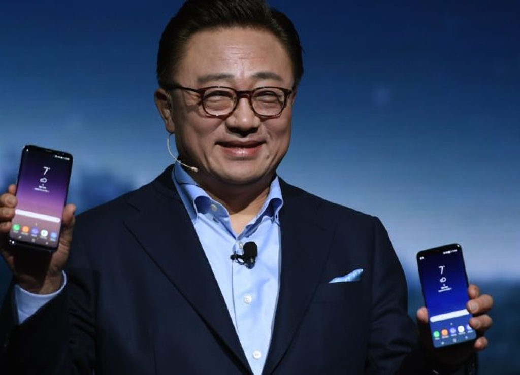 """DJ Koh Samsung President Mobile Communications Business introduces the new Samsung S8 and S8 Plus during a new conference on March 29, 2017 in New York. Samsung on Wednesday unveiled its new Galaxy S8 smartphones, incorporating its virtual assistant Bixby, as the market leader seeks to rebound from a chaotic handset recall and a corruption scandal.The two handsets, fitted with screens of 5.8 and 6.2 inches, include Samsung's upgraded digital assistant Bixby, competing in a crowded field that includes Apple's Siri, Google Assistant and Amazon Alexa. Koh said Bixby would provide users with """"more and more personalized help,"""" using voice commands to navigate apps and services. / AFP PHOTO / TIMOTHY A. CLARY (Photo credit should read TIMOTHY A. CLARY/AFP/Getty Images)"""