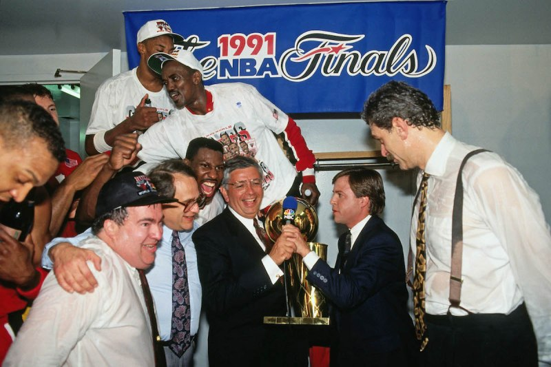 INGLEWOOD, CA - JUNE 12: Phil Jackson of the Chicago Bulls is presented the Finals trophy from NBA Commissioner David Stern after winning Game Five of the 1991 NBA Finals on June 12, 1991 at the Great Western Forum in Inglewood, California. The Chicago Bulls defeated the Los Angeles Lakers 4-1 to win the NBA Championship. NOTE TO USER: User expressly acknowledges and agrees that, by downloading and or using this photograph, User is consenting to the terms and conditions of the Getty Images License Agreement. Mandatory Copyright Notice: Copyright 1991 NBAE (Photo by Andrew D. Bernstein/NBAE via Getty Images)