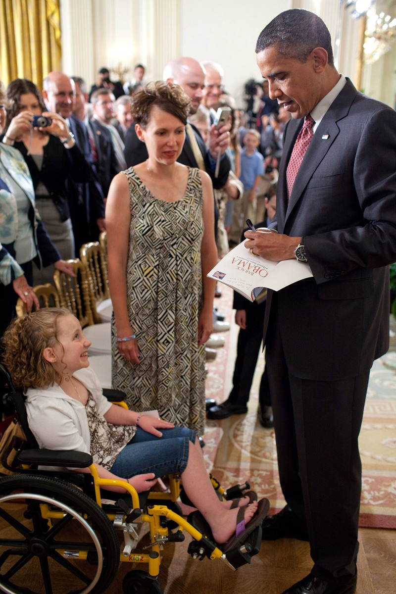 President Barack Obama talks with Amy Wilhite and daughter Taylor, who has Acute Myeloid Leukemia (AML), a fast-growing cancer of the blood and bone marrow, following his remarks on the 90-day anniversary of the signing of the Affordable Care Act, in the East Room of the White House, June 22, 2010. (Official White House Photo by Pete Souza)