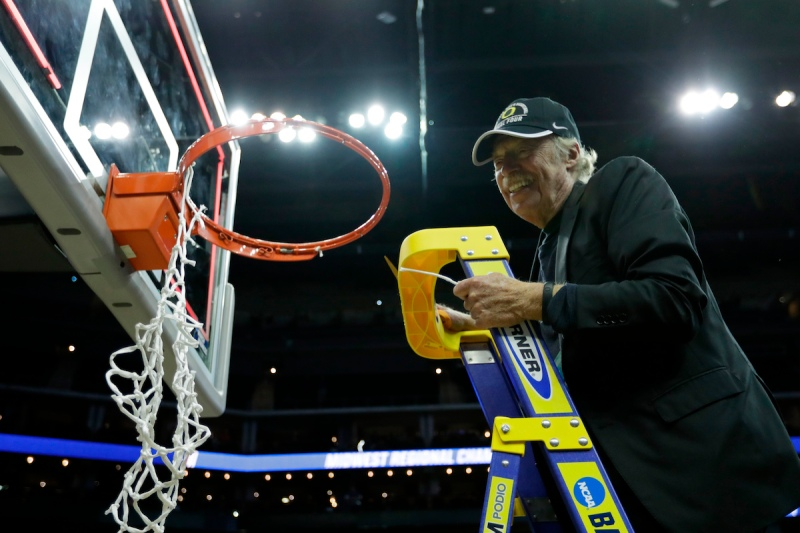 KANSAS CITY, MO - MARCH 25: Oregon alumni and co-founder and chairman emeritus of Nike, Inc. Phil Knight cuts down the net with the Oregon Ducks after their 74-60 win over the Kansas Jayhawks during the 2017 NCAA Men's Basketball Tournament Midwest Regional at Sprint Center on March 25, 2017 in Kansas City, Missouri. (Photo by Jamie Squire/Getty Images)