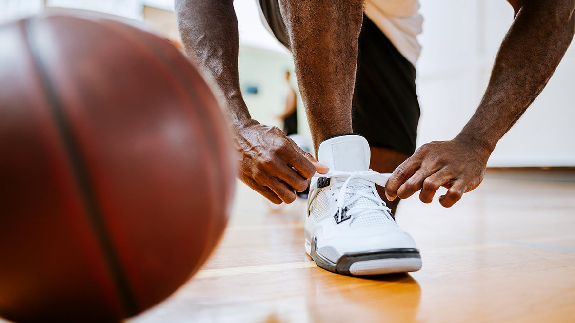 Close up of a basketball player tying up his shoelaces (Getty Images)