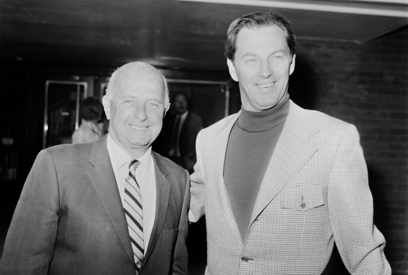 Norwegian-American businessman Kjell Qvale (1919 - 2013, right), a majority shareholder in Jensen Motors, is met at London Airport by English car designer and rally driver Donald Healey (1898 - 1988), 21st February 1971 (George Stroud/Daily Express/Getty Images)