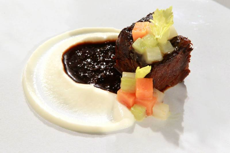 The 'restaurant' presentation of a meal of braised short ribs cooked by Chef Daniel Humm, of Manhattan's Eleven Madison Park, is featured in test kitchen, November 14, 2011, in Chicago, Illinois.