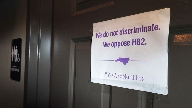 A unisex sign and the 'We Are Not This' slogan are outside a bathroom at Bull McCabes Irish Pub on May 10, 2016 in Durham, North Carolina. (Sara D. Davis/Stringer/Getty)