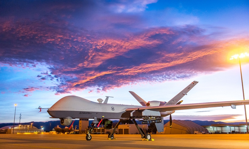 The sun rises over an MQ-9 Reaper remotely piloted aircraft at Holloman Air Force Base, N.M., Dec. 16, 2016. The 49th Aircraft Maintenance Squadron supports the 6th Reconnaissance Squadron as well as the 9th and 29th Attack Squadrons, enabling the graduation of pilots and sensor operators in support of the Air Force's largest formal training unit. Additionally, Airmen with the 49th AMS continuously deploy in support of intelligence, surveillance, and reconnaissance requirements. (U.S. Air Force photo by J.M. Eddins Jr.)