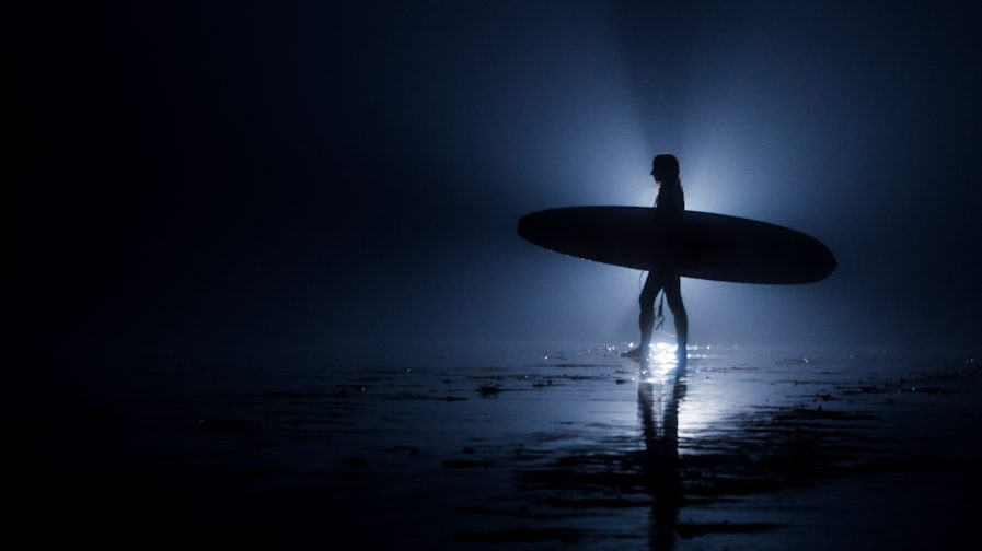 New Surfing Trend: Surfing at Night Under the Moon