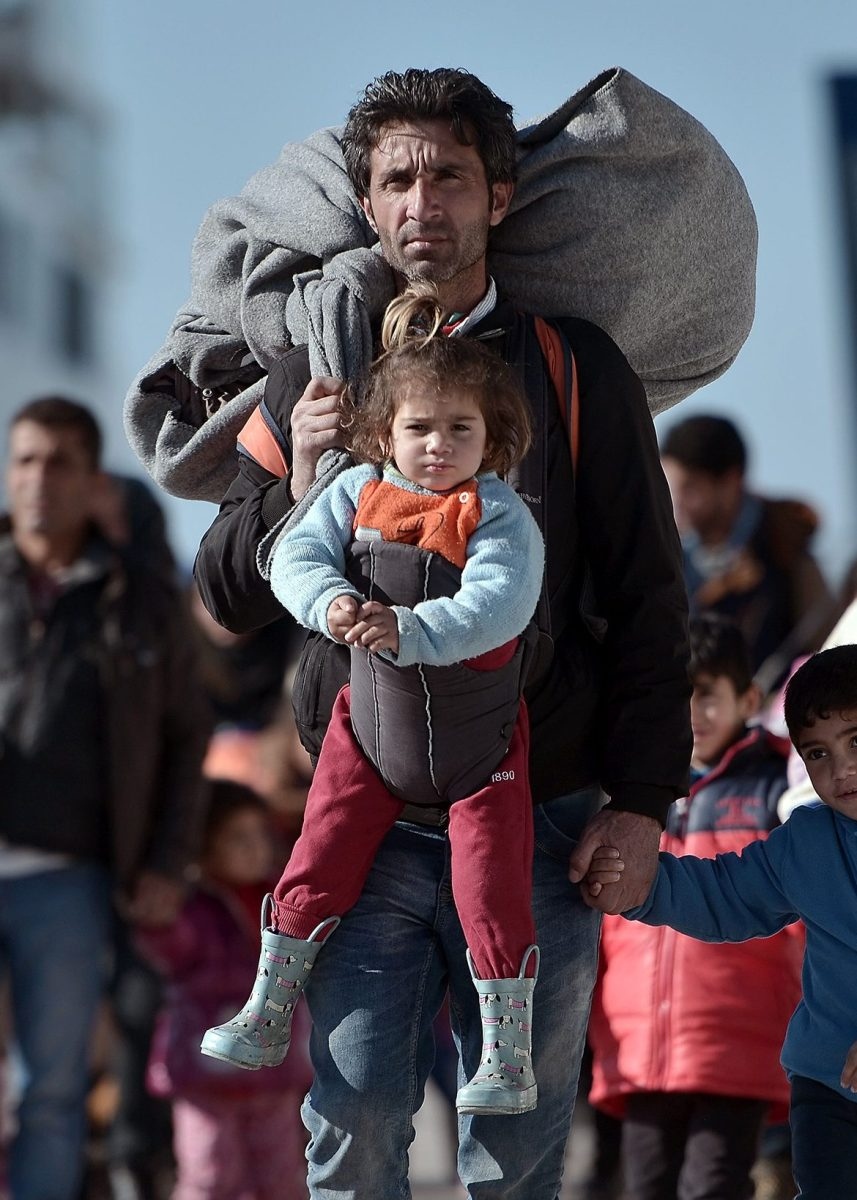 TOPSHOT - Thousands of migrants and refugees walk through the port of Piraeus after arriving from the Greek islands of Lesbos and Chios on February 1, 2016. On average, more than 1,900 people have arrived each day this month on Greek islands on unseaworthy boats from Turkey, according to the UN, which put the total of new arrivals in January at more than 50,000. More than 31,000 people have been registered on Lesbos during that time, the UN added. / AFP / LOUISA GOULIAMAKI        (Photo credit should read LOUISA GOULIAMAKI/AFP/Getty Images)
