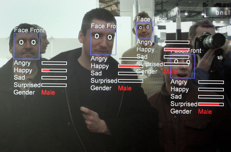 "A photo of a computer screen running ""Real Time Face Detector"" software shows visitors' expressions analysed and explained in real time at the stand of the Fraunhofer Institute at the CeBIT trade fair in Hanover on March 6, 2008. The Real Time Face Detector is a software module that can be used for fast face detection in videostreams and single pictures. AFP PHOTO JOHN MACDOUGALL (Photo credit should read JOHN MACDOUGALL/AFP/Getty Images)"