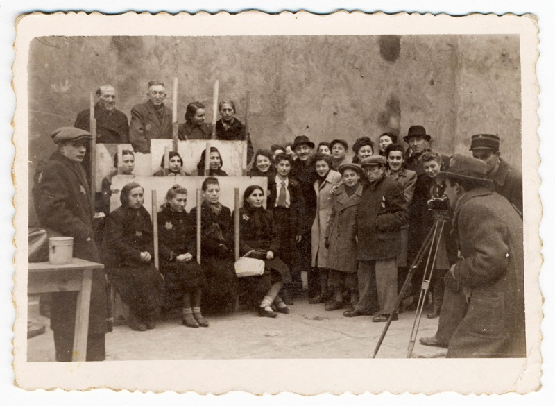Lodz ghetto: Henryk Ross photographing for identification cards, Jewish Administration, Department of Statistics (Henryk Ross/Art Gallery of Ontario) 1940 Gelatin silver print *Art Gallery of Ontario. Gift from the Archive of Modern Conflict, 2007 *© Art Gallery of Ontario *Courtesy, Museum of Fine Arts, Boston