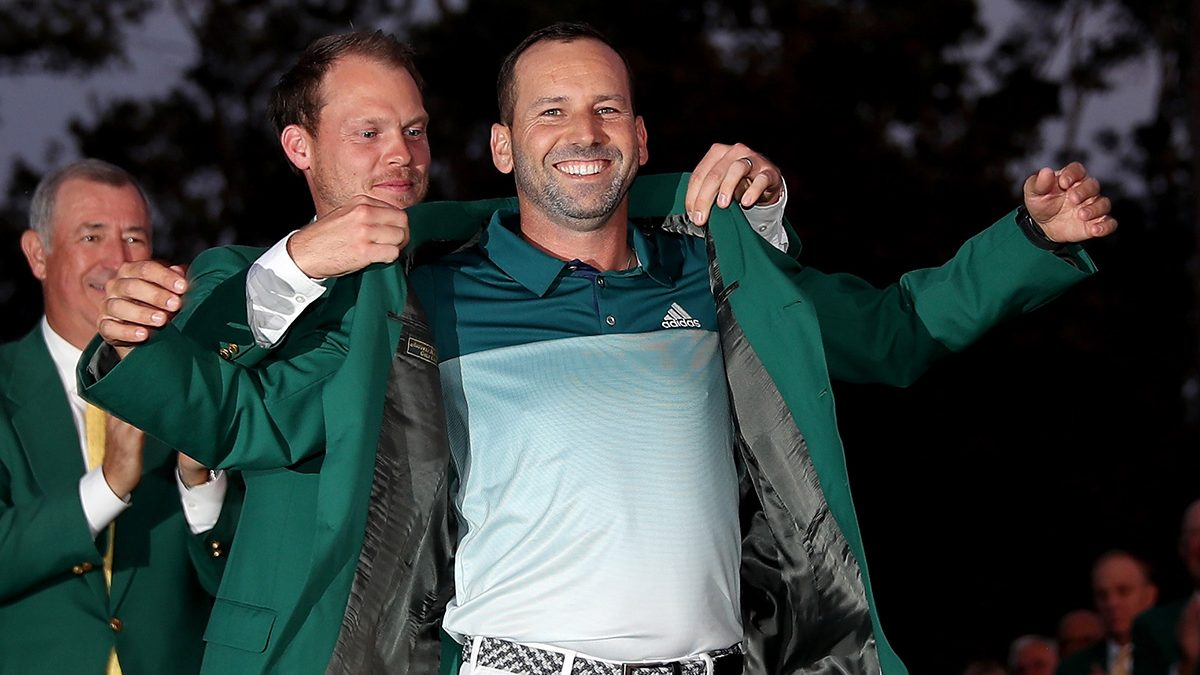 Danny Willett of England presents Sergio Garcia of Spain with the green jacket after Garcia won in a playoff during the final round of the 2017 Masters Tournament at Augusta National Golf Club on April 9, 2017 in Augusta, Georgia. (David Cannon/Getty Images)