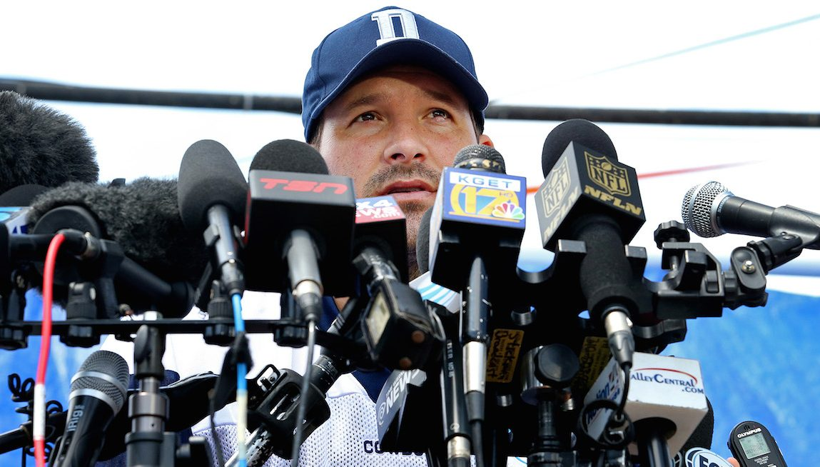 Dallas Cowboys quarterback Tony Romo is behind a wall of microphones during his media availability after the team's morning walk through during training camp in Oxnard, Calif., on Thursday, July 30, 2015. (Paul Moseley/Fort Worth Star-Telegram/TNS via Getty Images)