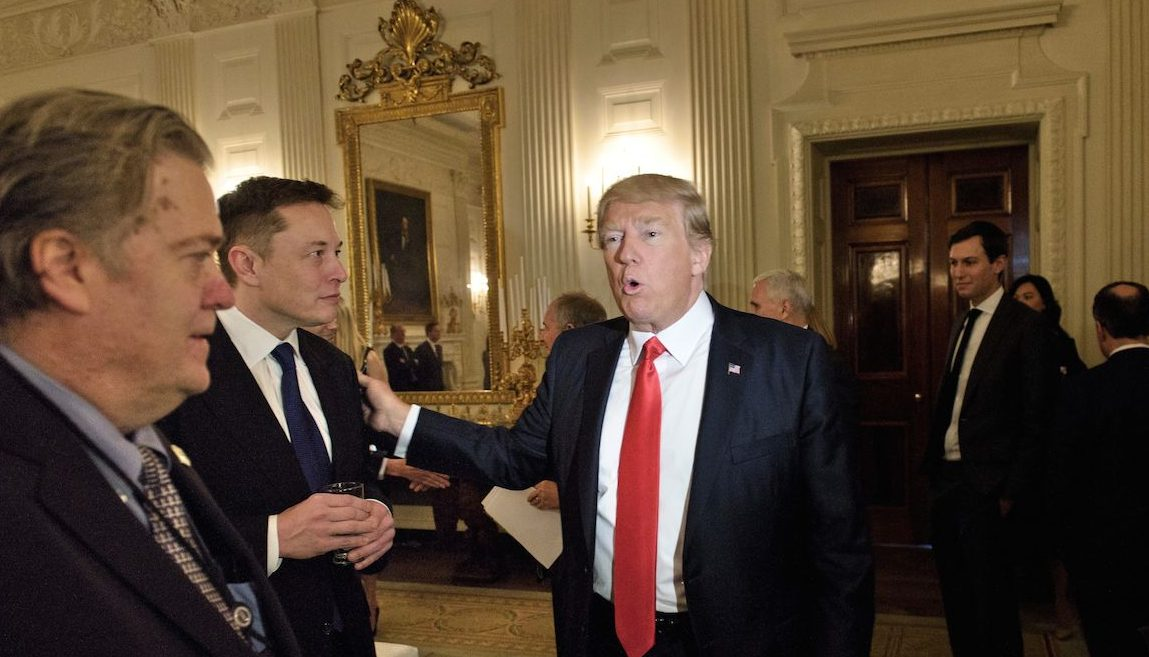 Trump advisor Steve Bannon (L) watches as US President Donald Trump greets Elon Musk, SpaceX and Tesla CEO, before a policy and strategy forum with executives in the State Dining Room of the White House February 3, 2017 in Washington, DC. / AFP / Brendan Smialowski        (Photo credit should read BRENDAN SMIALOWSKI/AFP/Getty Images)