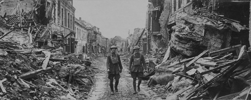 soldiers walking through damaged streets, France. (Photo by Pen & Sword/SSPL/Getty Images)