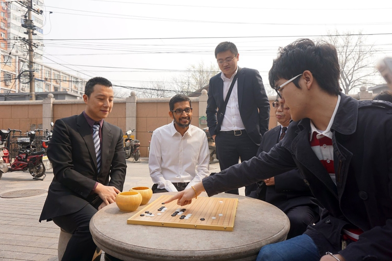 Ke Jie, far right, has recreated the opening moves of one of AlphaGo's games with Lee Sedol from memory to explain the beauty of its moves to Google CEO Sundar Pichai during a visit he made to Nie Weiping's Go school in Beijing last year.