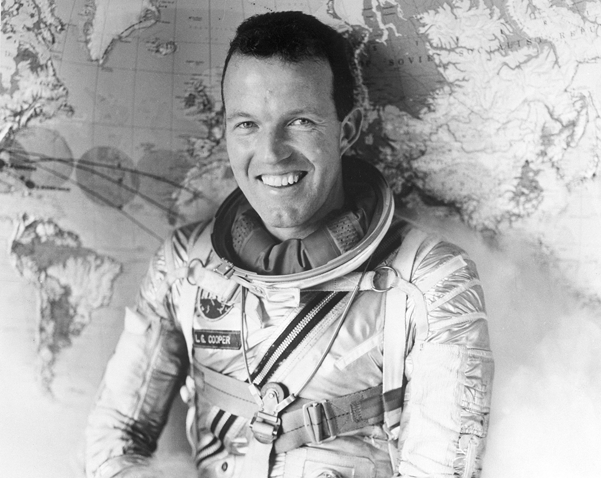 Major L. Gordon Cooper poses in front of a map while wearing a space suit. Cooper, a 35 year old from Shawnee, Oklahoma is slated to pilot the next Mercury space flight in which he is expected to circle the earth 18 times in a flight lasting 24 hours. The flight is scheduled for April, 1963. Washington, D.C.
