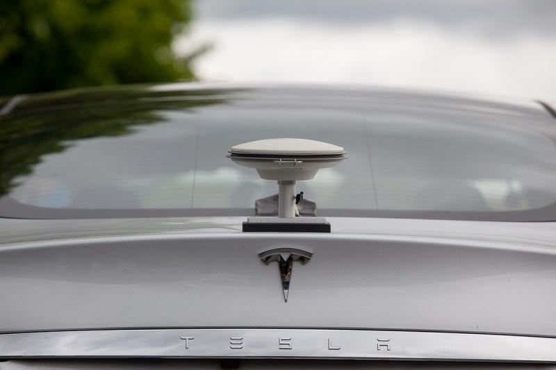 A GPS driving sensor antennae sits on the back of a Tesla Motors Inc. (Krisztian Bocsi/Bloomberg via Getty Images)