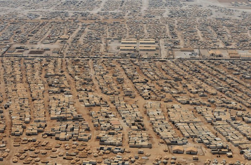 An aerial view shows the Zaatari refugee camp on July 18, 2013 near the Jordanian city of Mafraq, some 8 kilometers from the Jordanian-Syrian border. The northern Jordanian Zaatari refugee camp is home to 115,000 Syrians. (AFP PHOTO/MANDEL NGAN/POOL)