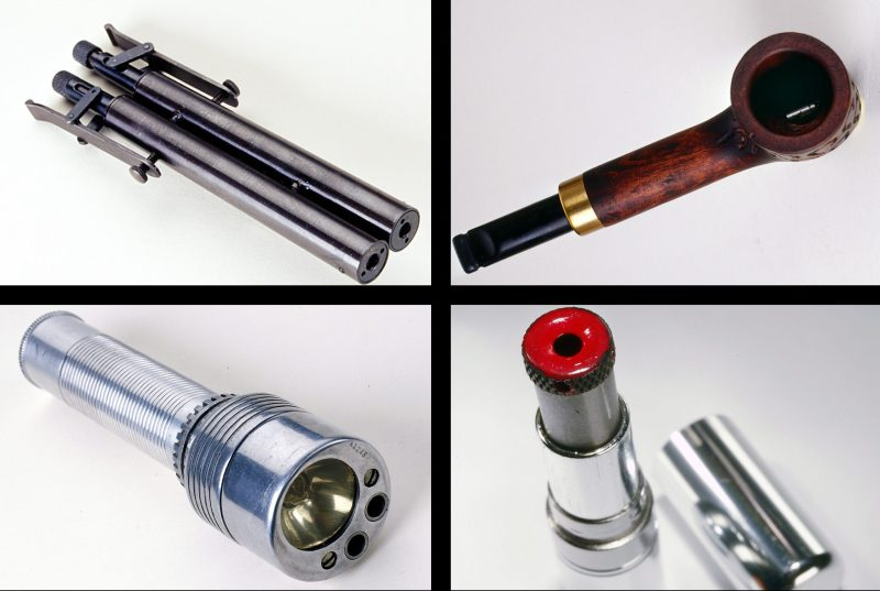 Clockwise, from top left: Poison gas gun used for KGB assassinations, a gun concealed in a tobacco pipe, a gun concealed in a tube of lipstick, and a flashlight gun. (Courtesy of the International Spy Museum)