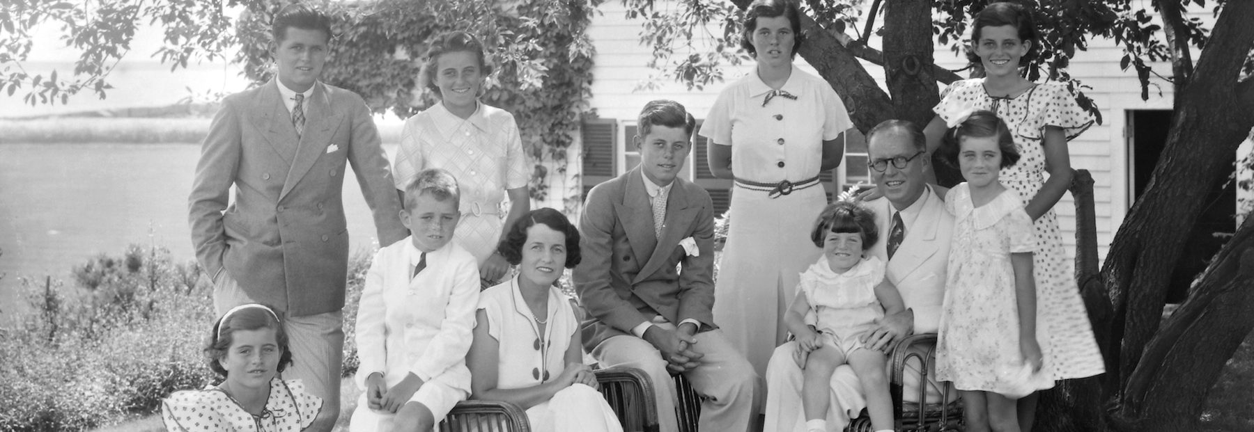 A portrait of the Kennedy family,  1930s. Seated from left are: Patricia Kennedy, Robert Kennedy, Rose Kennedy, John F Kennedy, Joseph P Kennedy Sr with Edward Kennedy on his lap; standing from left are: Joseph P Kennedy Jr, Kathleen Kennedy, Rosemary Kennedy, Eunice Kennedy (rear, in polka dots), and Jean Kennedy. (Bachrach/Getty Images)