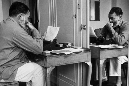 hemingway sits at his typewriter