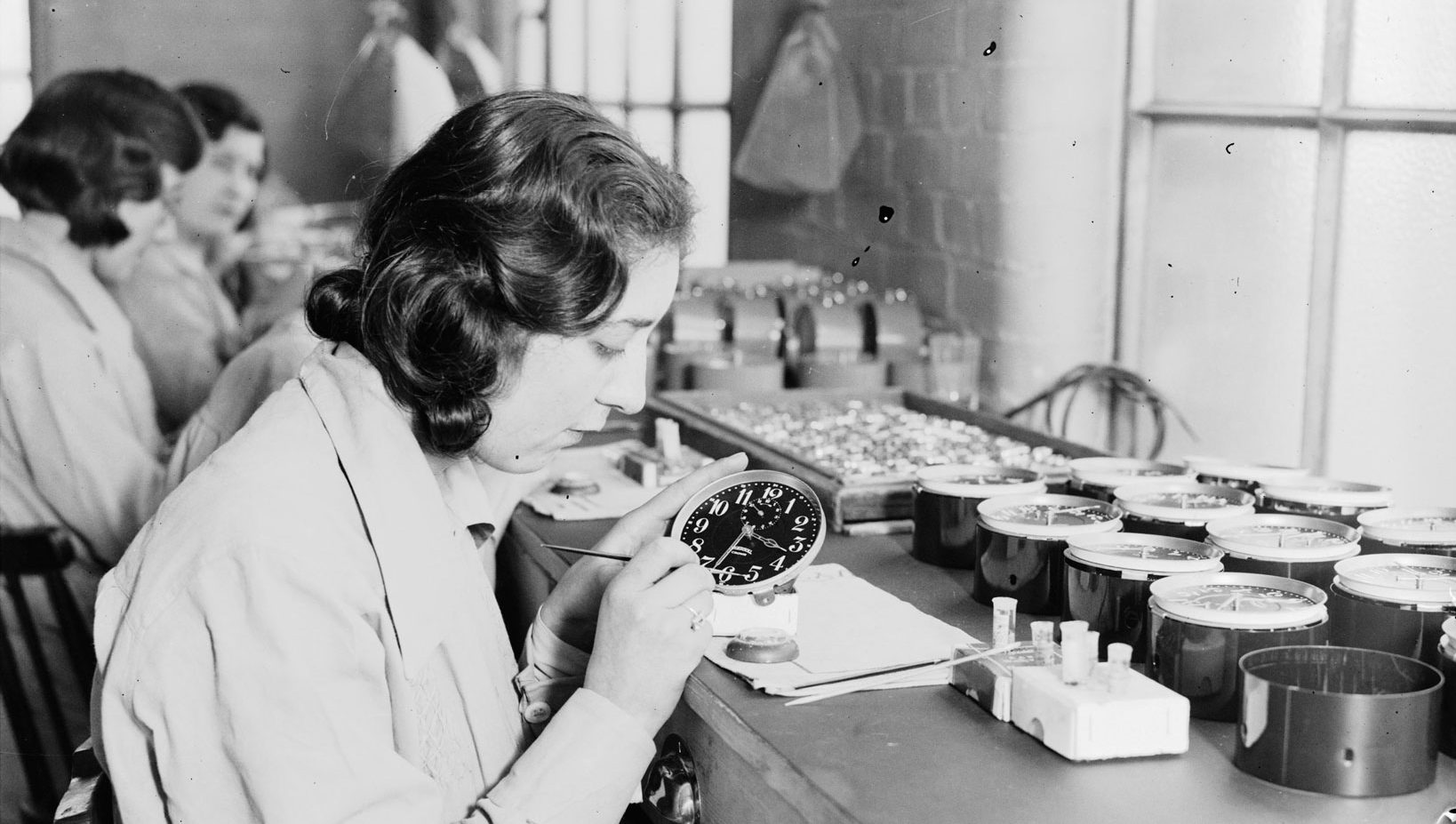 Women painting alarm clock faces with radium-laden paint in January 1932. (Daily Herald Archive/SSPL/Getty Images)