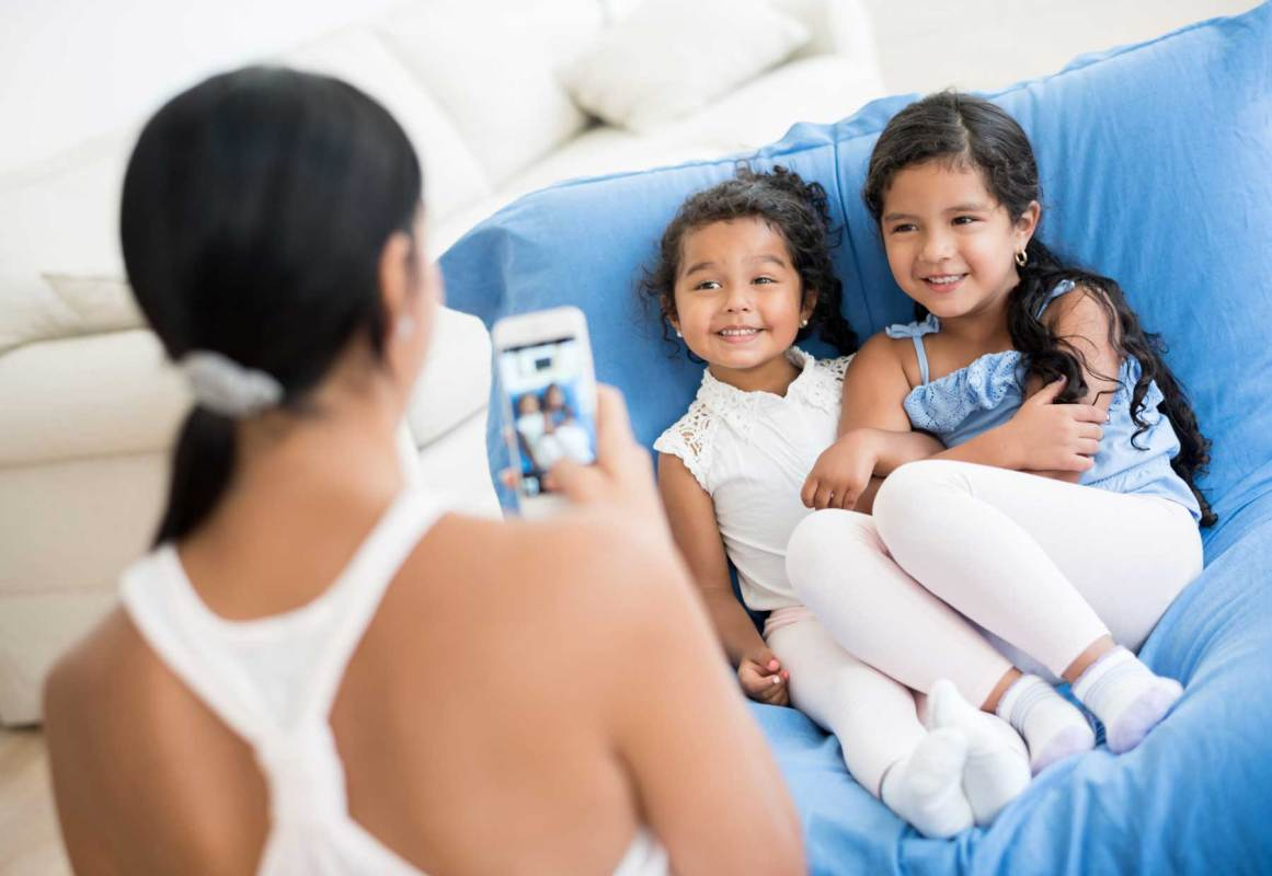 Kids have strong opinions about what their parents share. (Getty Images)
