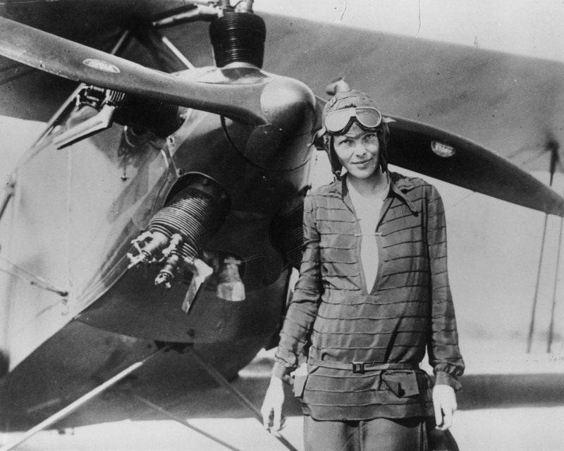 "Amelia Earhart stands June 14, 1928 in front of her bi-plane called ""Friendship"" in Newfoundland. Earhart (1898 - 1937) disappeared without trace over the Pacific Ocean in her attempt to fly around the world in 1937."