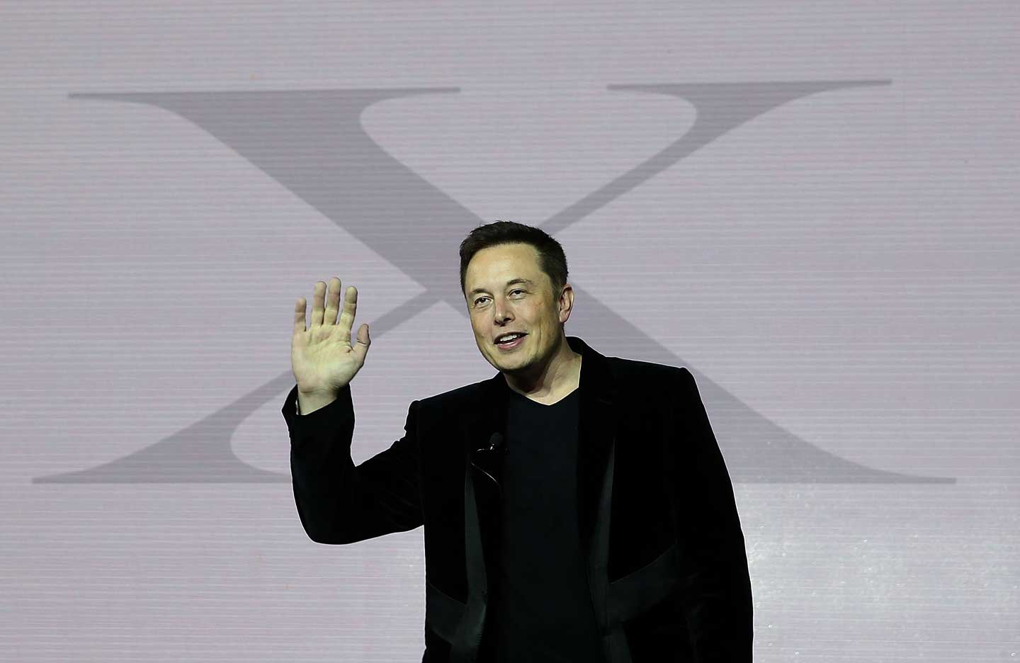 Tesla CEO Elon Musk speaks during an event to launch the new Tesla Model X Crossover SUV on September 29, 2015 in Fremont, California. Musk recently announced a major donation to Flint Community Schools. (Justin Sullivan/Getty Images)