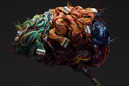 A model of the human brain constructed of wires and ports. (Getty)