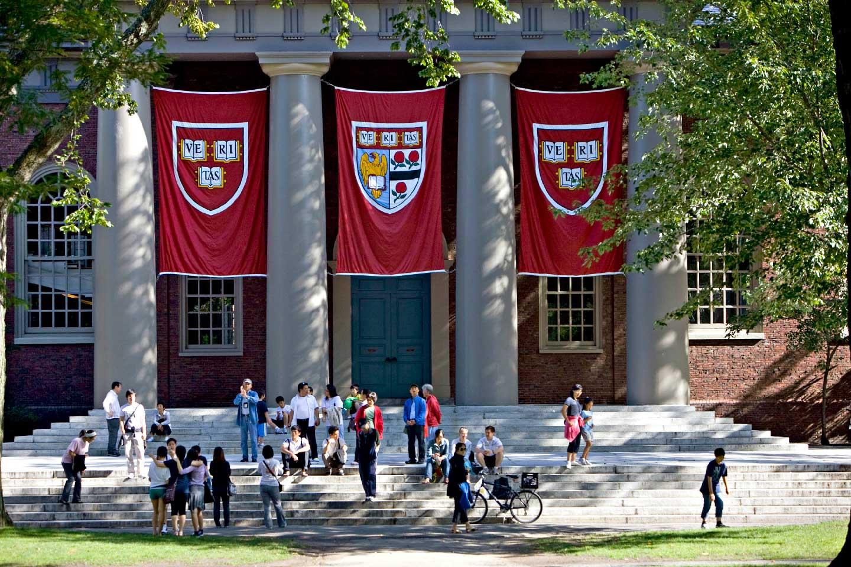Harvard banners hang outside Memorial Church on the Harvard University campus in Cambridge, Massachusetts, U.S., on Friday, Sept. 4, 2009. (Michael Fein/Bloomberg via Getty Images)